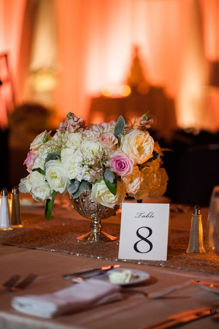 The elegant décor included candles, silver mercury glass compotes, tall glass vases and soft peony arrangements.