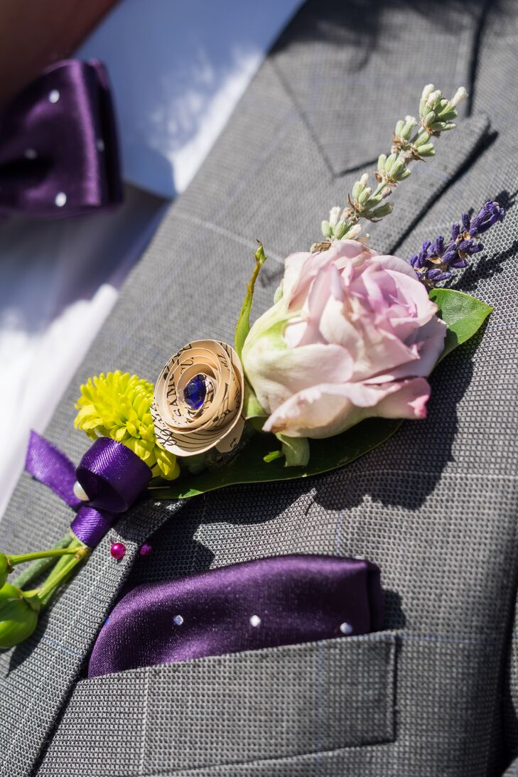 Chris wore a rose, lavender and paper flower boutonniere on the lapel of his gray J.Crew suit. The groom included his favorite color, purple, by wearing a matching  polka dot bow tie and pocket square.