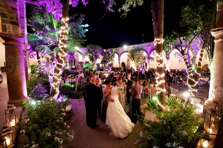 Bright purple uplight and twinkling white lights turned the courtyard at the historic Instituto Allende into a lively, party-ready scene. After dinner, the couple's DJ took to the floor and got guests dancing all night long with his upbeat mix of hits.