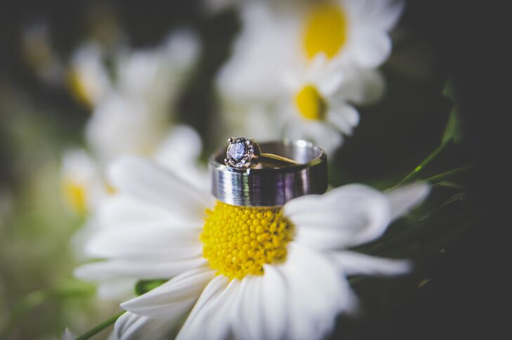 The classic silver wedding rings were positioned on top of a white daisy with a yellow center, which was Beth's favorite flower.