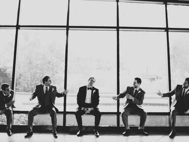 Groomsmen and groom in tuxedos