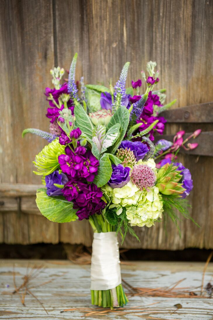 The bride carried a bouquet of purple flowers down the aisle, including veronica, stock flowers, hydrangeas and scabiosas.
