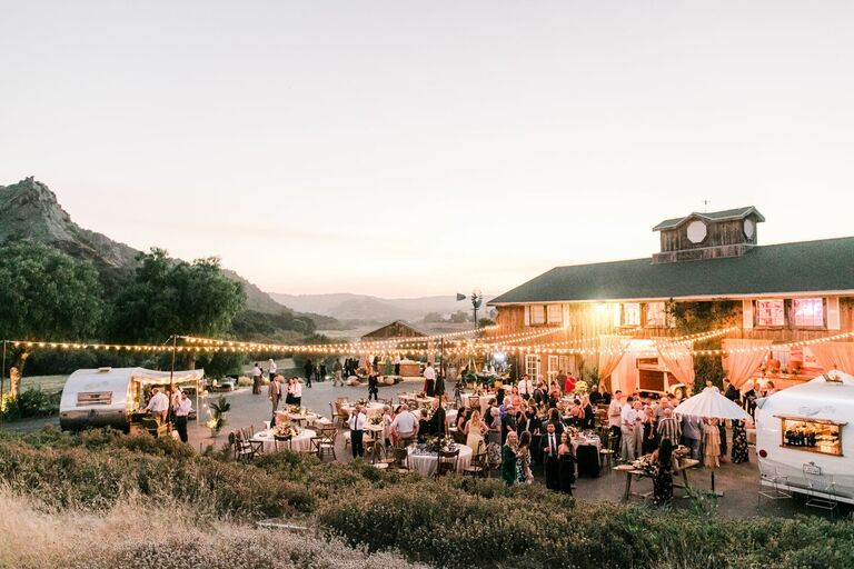 Outdoor reception at sunset with string lights