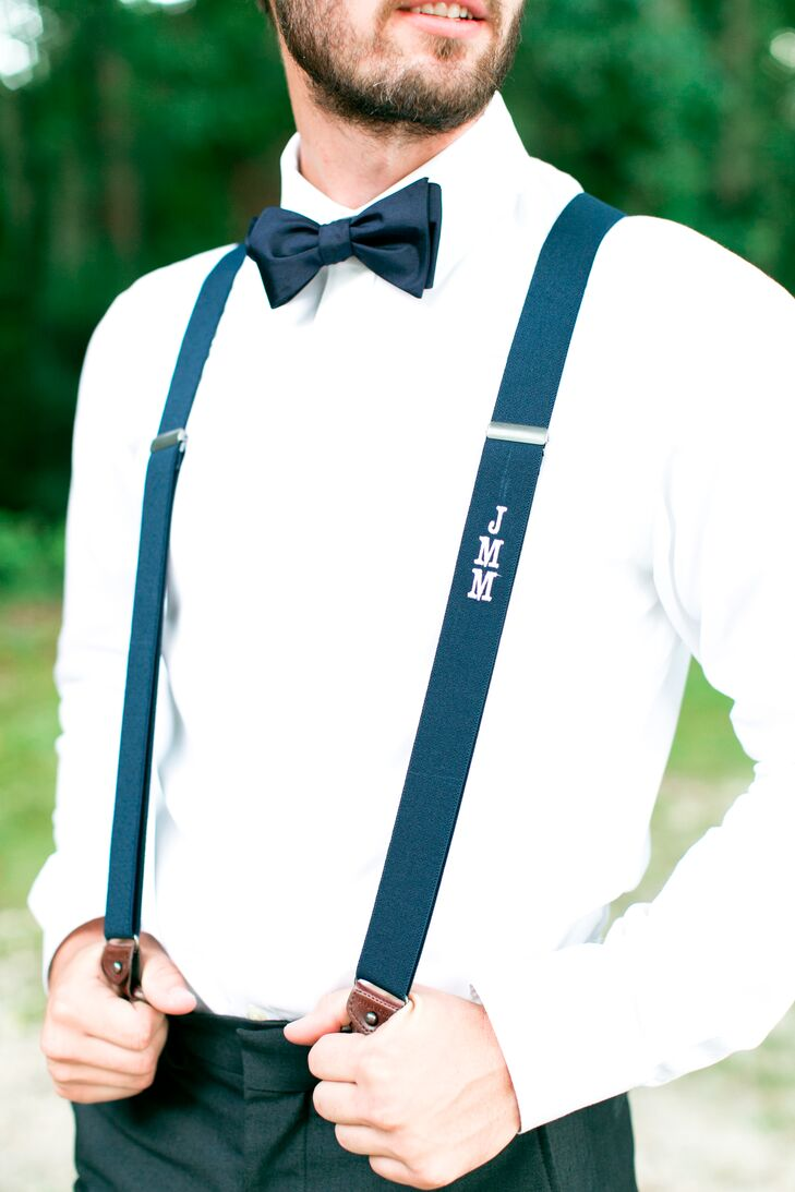 The groomsmen sported classic navy bow ties that contrasted with Matt's polka-dot tie but kept a similar color scheme. Each groomsman also wore a pair of navy suspenders with his initials monogrammed vertically in white for a Southern touch.