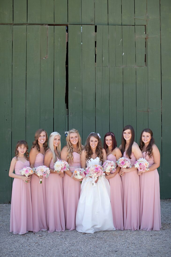 The bridesmaids wore matching pink, floor-length dresses.