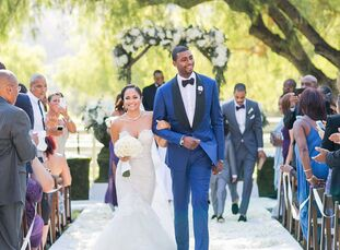ILush blooms and polished tones of plum, gray and champagne brought Mia Lee (29 and an entrepreneur) and Dorell Wright's (28 and an NBA player) chic o