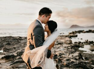 Eleven years after meeting at their high school's carnival as teenagers, Brett married Chanel in an elegant outdoor ceremony at Lanikuhonua Cultural I