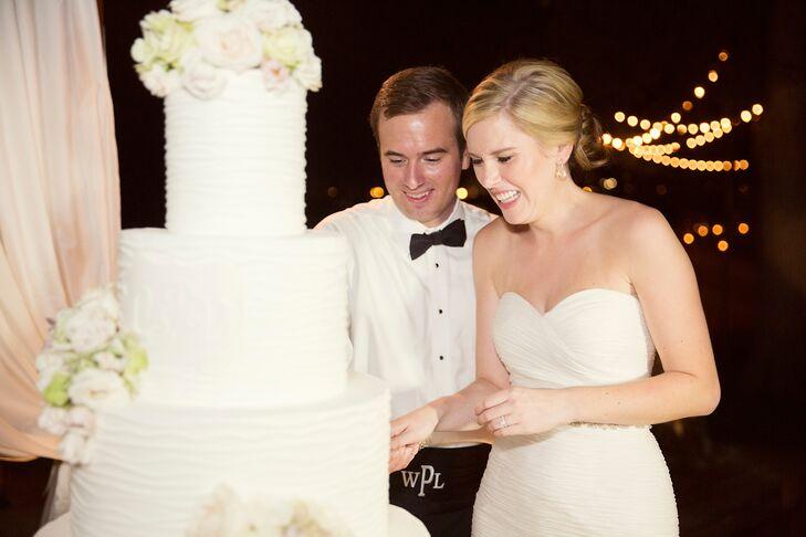 White Buttercream Wedding Cake Cutting
