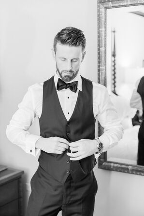 Groom's Classic Black Suite With Vest and Bow Tie