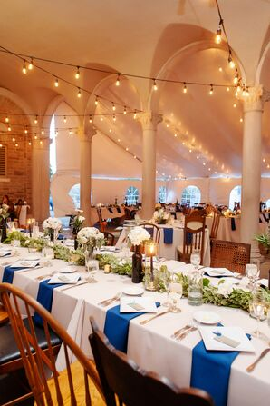 Tented Bohemian Reception with String Lights and Greenery Centerpieces