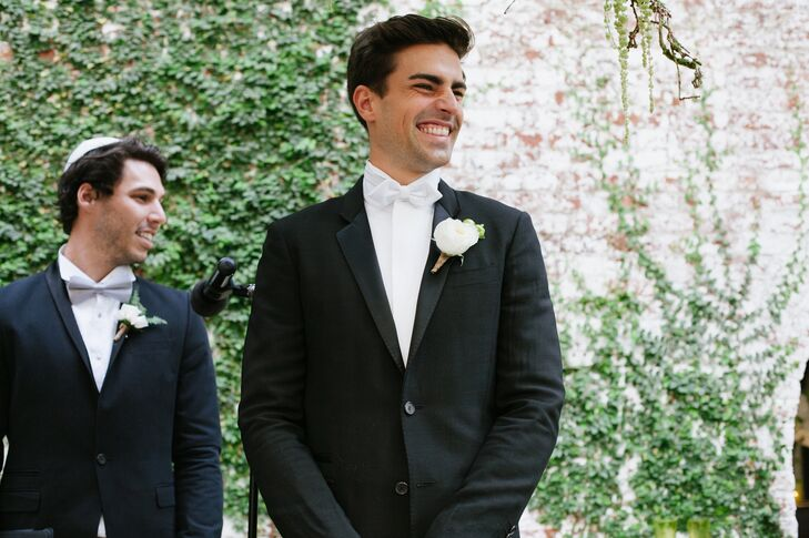 Black Givency Groom's Tuxedo with White Rose Boutonniere