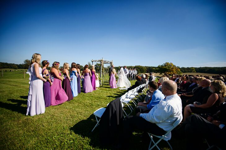 The ceremony took place outside under a birch tree arbor. The wide expanse of greenery on the cattle farm held large barrels  of hay surrounded by trees in seasonal transition, winding country roads and big rolling hills.