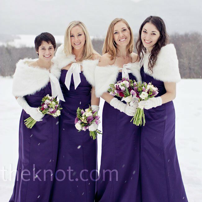 The bridesmaids wore floor-length plum dresses and kept warm in white, faux-fur boleros.