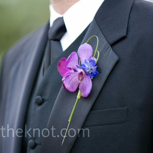 Vanda orchids worked the day's main color into the groomsmen's looks. Looped bear grass gave the boutonnieres a unique shape.