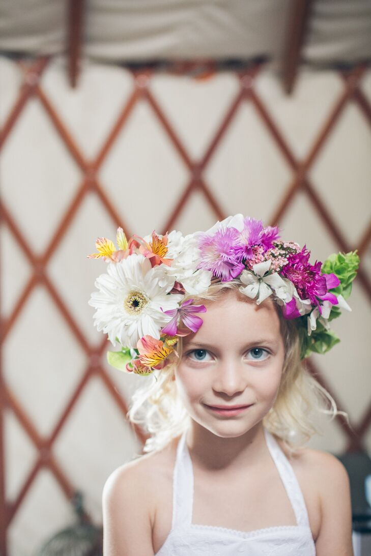 One of the bridesmaids made all the flower crowns for the wedding. This included the flower girl's crown, arranged with bright pink and white blooms.