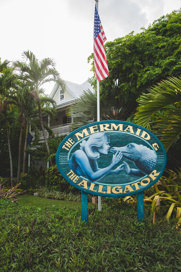 """Within one phone call we had our venue, lodging and officiant booked!"" says Danielle. The couple chose The Mermaid and the Alligator in Key West, Florida, to house their celebration. Danielle and Brian had their ceremony in the venue's tropical garden and said ""I do"" under a canopy of greenery."