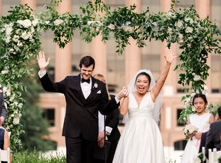 Wenqi Zhang and Mackie Woodruff had a multicultural wedding celebrating the groom's western Michigan roots and the bride's Chinese heritage. The cerem