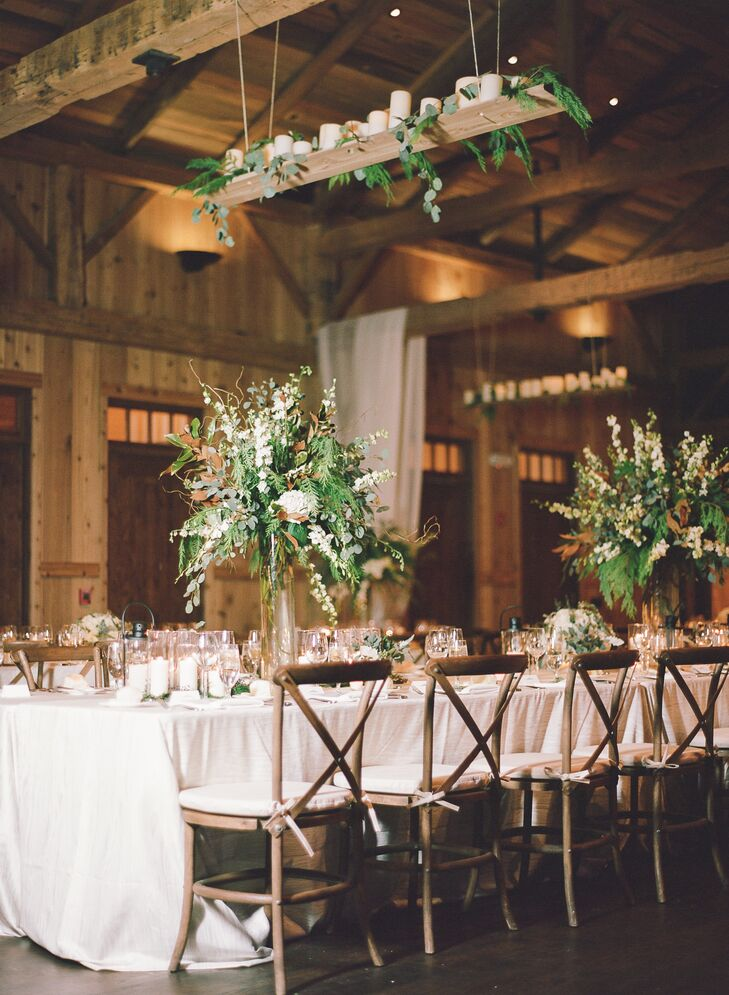"""One of our favorite elements were the handmade wooden shelf chandeliers with candles and hanging greenery,"" Charlotte says. ""They added beautiful warmth to the space."""