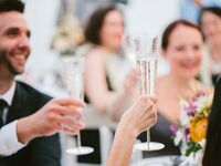 Champagne wedding toast at outdoor Hawaii reception