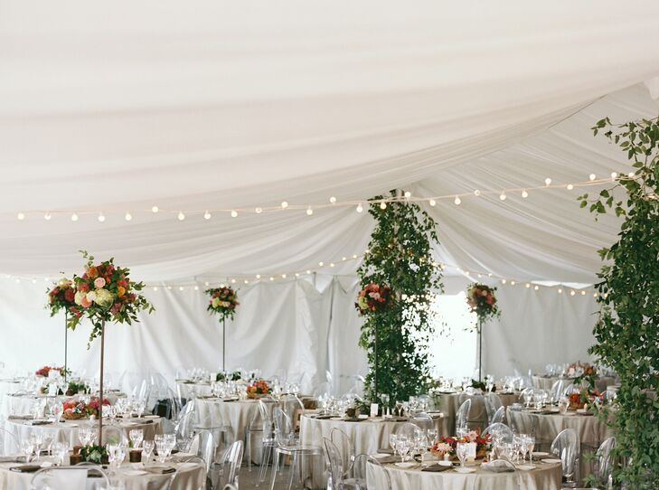 The party continued under a white tent bedecked with string lights. Tall, floral centerpieces brought pops of color into the space.