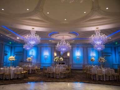 wedding ballroom with blue uplighting