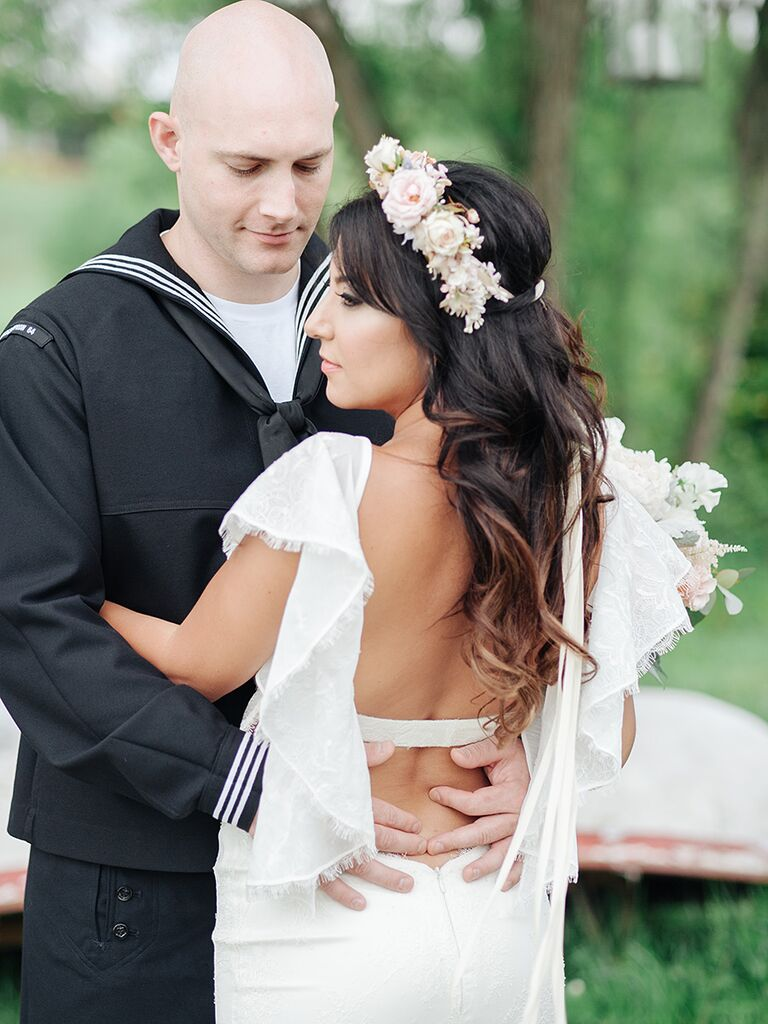 Long curly hair wedding hairstyle with a flower crown