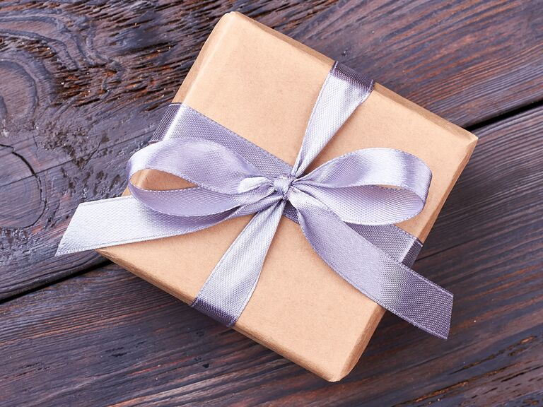 gift-wrapped box with purple ribbon