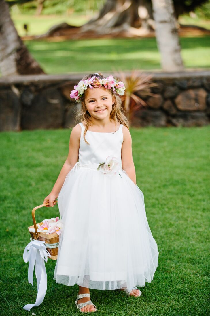 Olivia and Clayton's flower girl embraced the bohemian, tropical theme and wore a colorful pink and ivory flower crown.