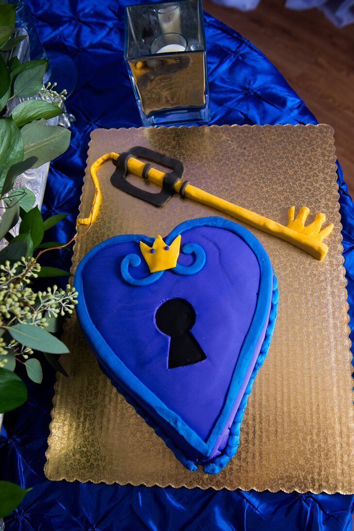 """""""Our groom's cake was an homage to Kingdom Hearts, the video game that brought us both together,"""" says the bride."""