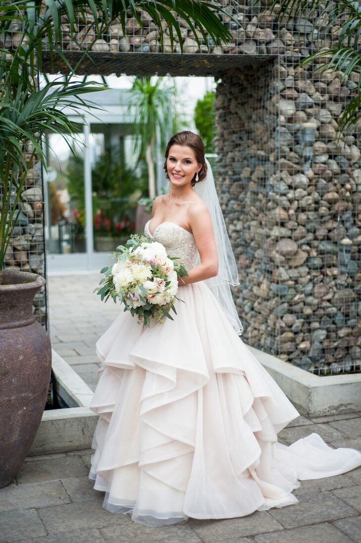 """I was open-minded when it came to my dress,"" Katina says. She tried on several styles at different salons, instantly falling in love with a Martina Liana two-piece gown with a sweetheart neckline and a ruched corset tulle skirt."