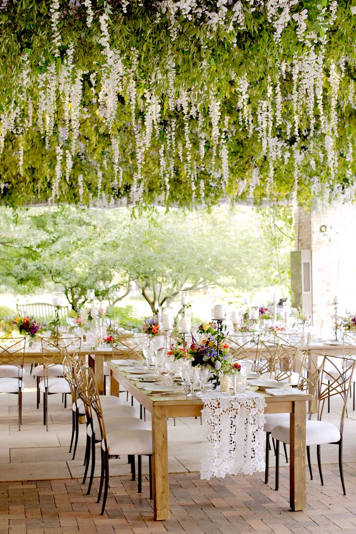 More than 14,000 stems of white wisteria hung from the ceiling of the dinner tent the Chicago Botanic Garden; white and gold chairs glammed up the reclaimed-wood feasting tables.