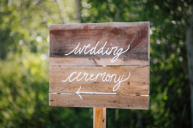 After guests took a ski lift at Park City Mountain Resort in Park City, Utah, a handcrafted wooden sign directed them to the ceremony site.
