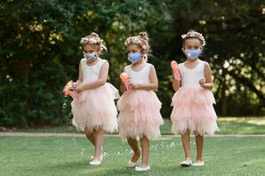 Flower Girls Walking Down the Aisle With Bubble Makers