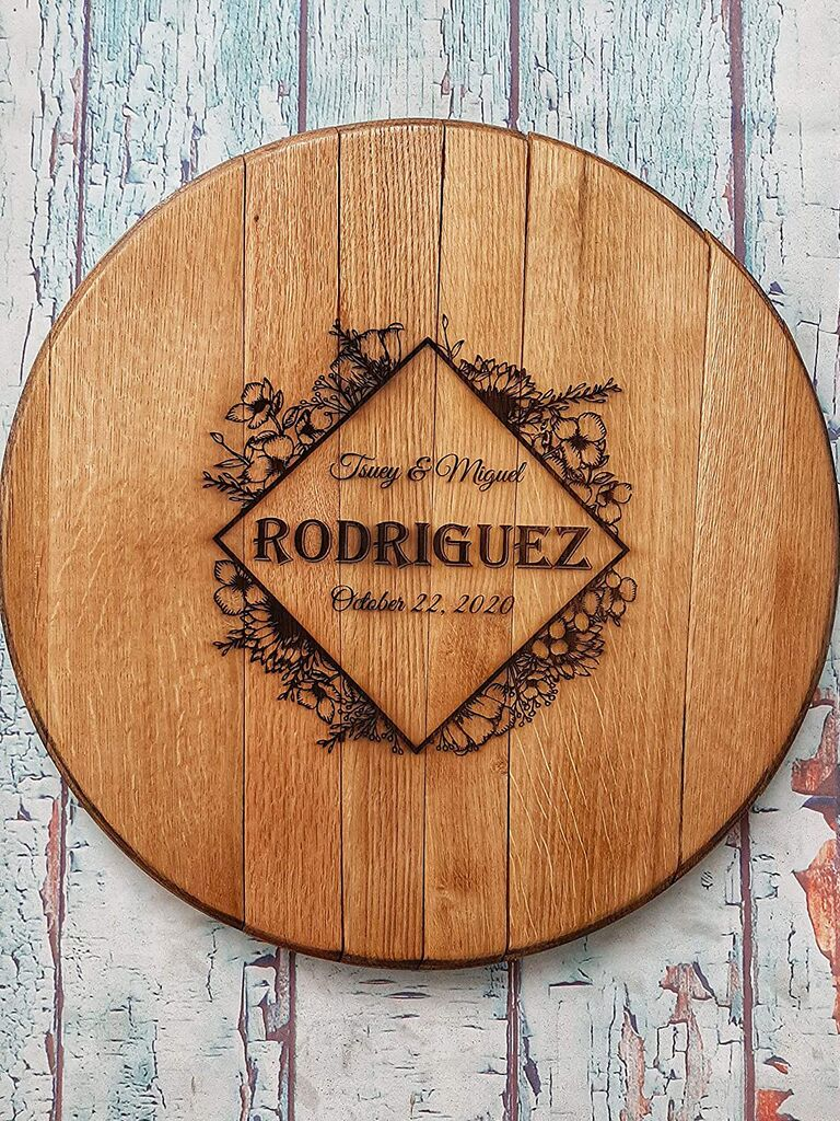 Circular wooden guest book slab personalized with couple's names