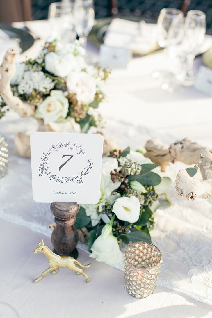 "Cynthia spent the months leading up to the wedding handcrafting small touches that would give the decor a fun, personalized feel. ""Andy is 6' 5"", like a giraffe, and I love the good luck that elephants bring, so I was excited when I found a DIY blog post with gold spray painted toy animals,"" says Cynthia. The gilded fauna were woven throughout and injected a whimsical, glam note to the tablescape design."