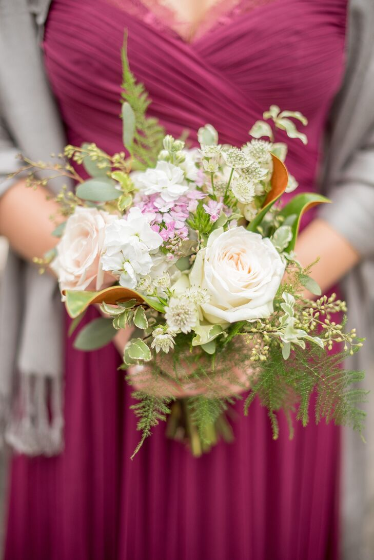 Bridesmaids carried small bouquets of white, ivory and champagne roses, mini green hydrangeas, dahlias and green foliage.