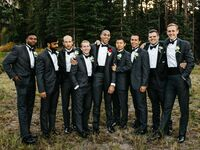 groomsmen in classic black and charcoal tuxedos