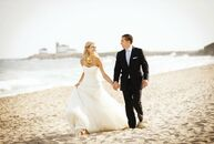 Ashley and Fred wanted an elegant look that wasn't too formal for their beach setting. They agreed on a soft palette of peach, blue and white for thei