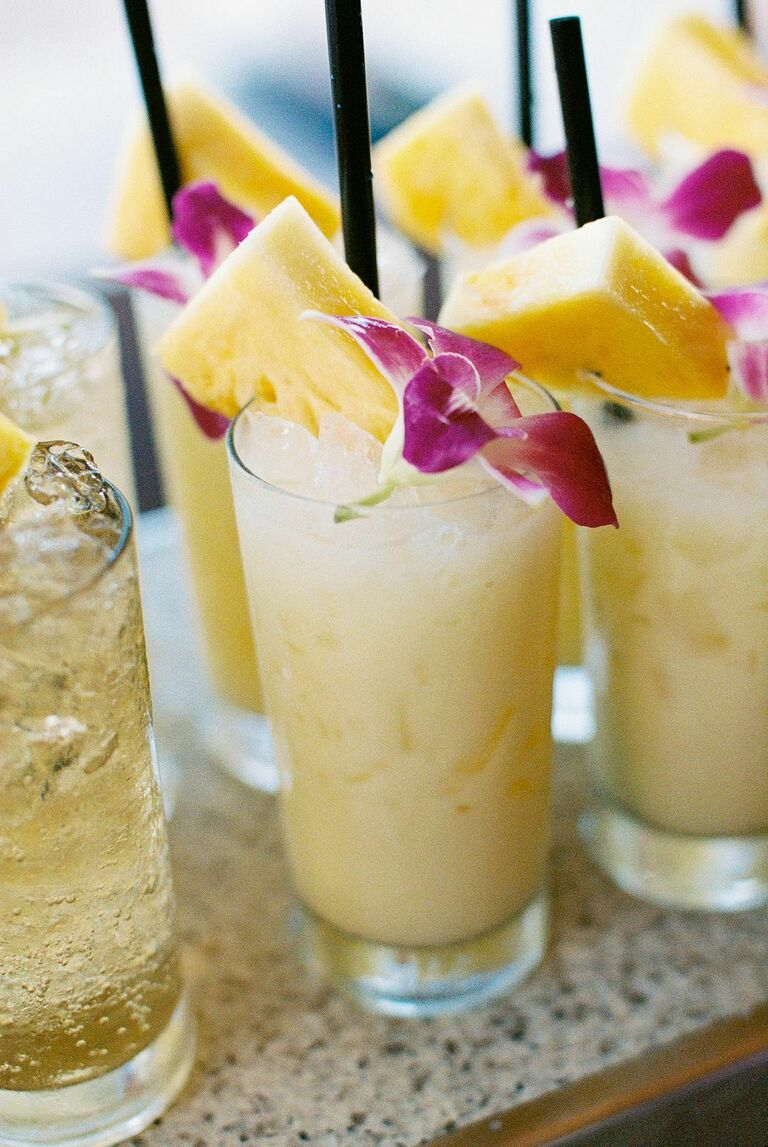 Pina coladas with orchid garnishes