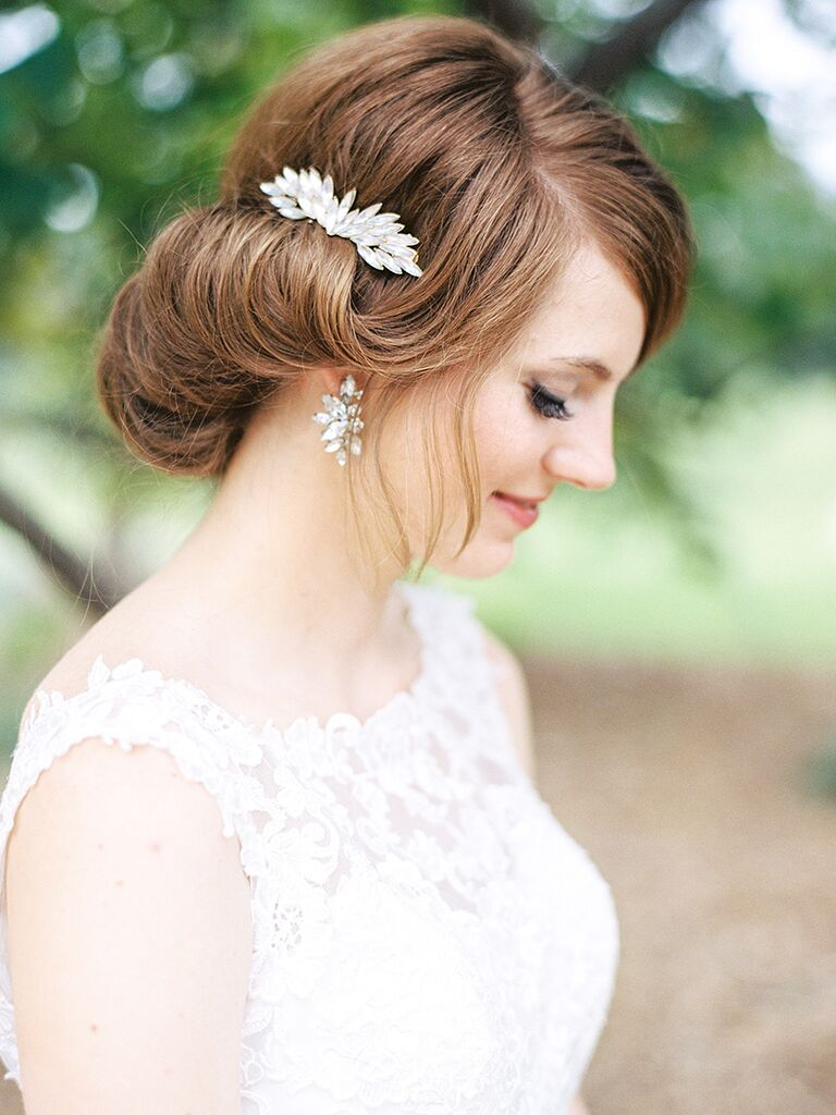 Vintage style roll and tuck updo with glam hair accessory