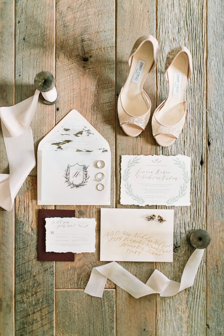 A custom invitation suite in blush was assembled with hand-drawn flourishes, a custom crest, tea-dyed ribbon and envelopes lined with birch.