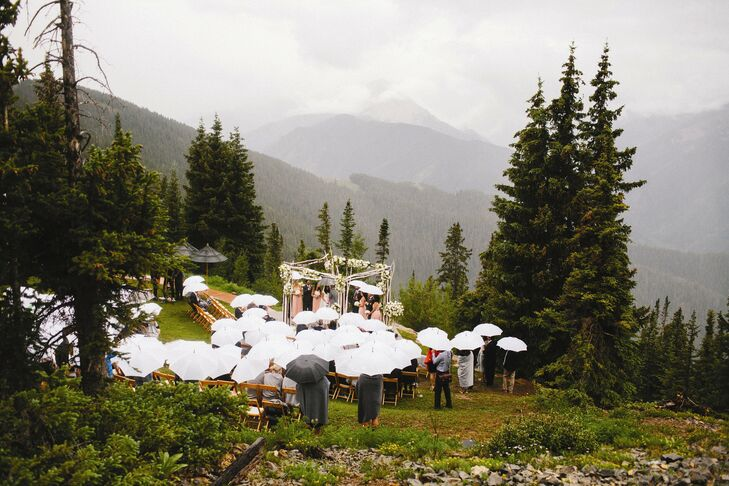 The couple was not deterred by the sudden rainstorm--they still held their ceremony outside.