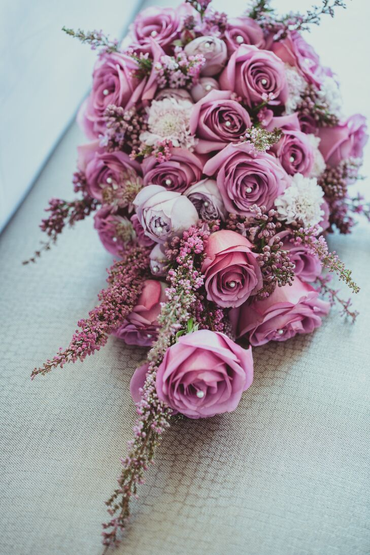 Dongli held a bouquet of roses with beaded centers accented with veronica, in different hues of purple that embodied a beautiful blend of the main color used at the wedding.