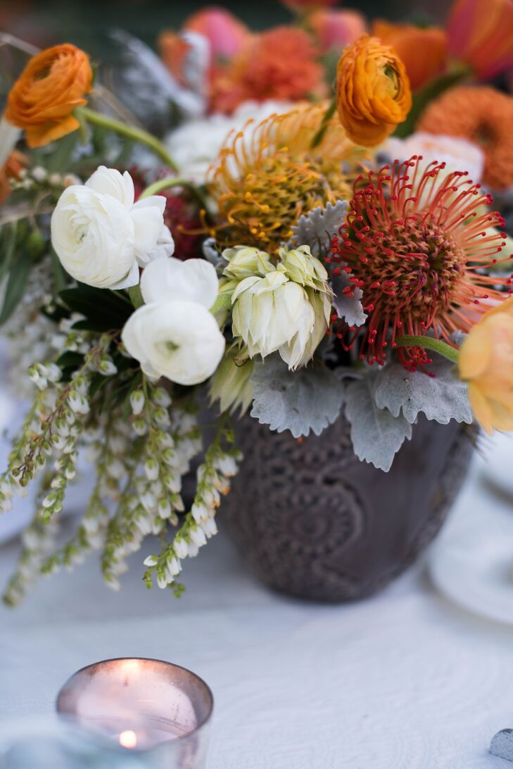 Autumnal Protea and Ranunculus Centerpiece
