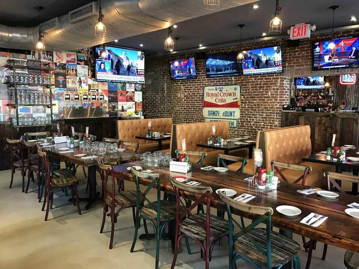Indoors of Dukes with TVS tables and chairs