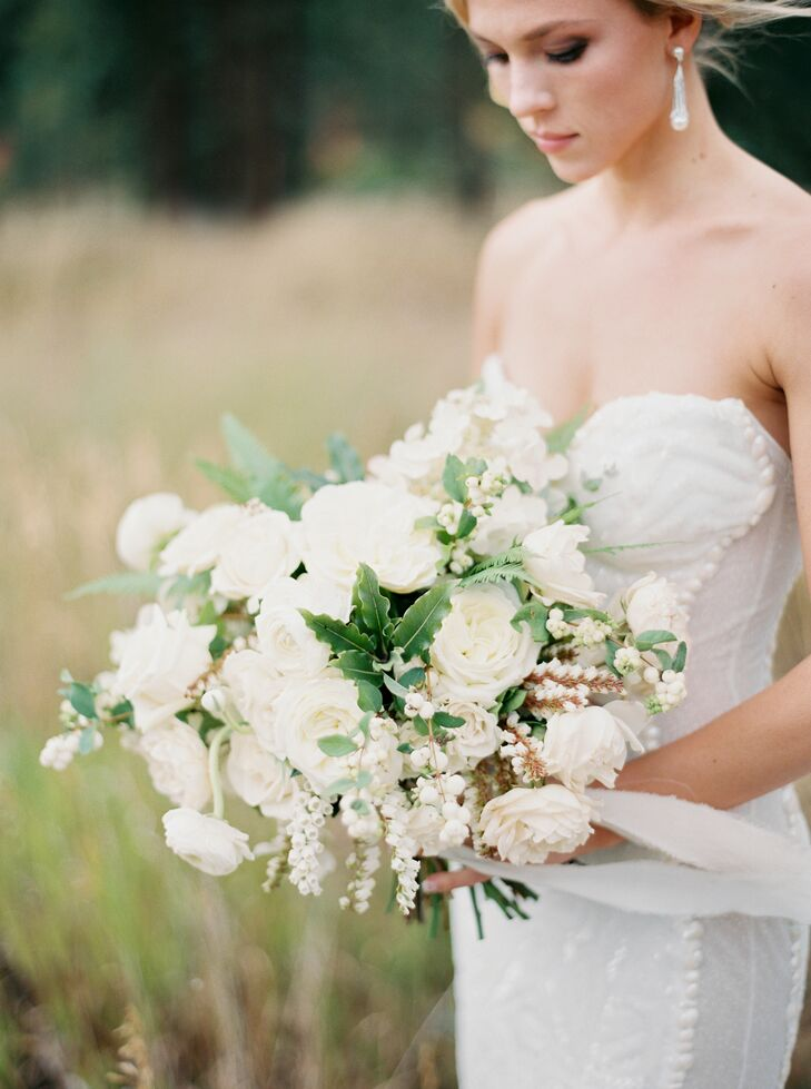Morgan's bouquet consisted of cream hydrangeas, ivory garden roses and greenery. The bouquet had a long, flowing hand-dyed ribbon wrapped around the base, from Tono & Co.