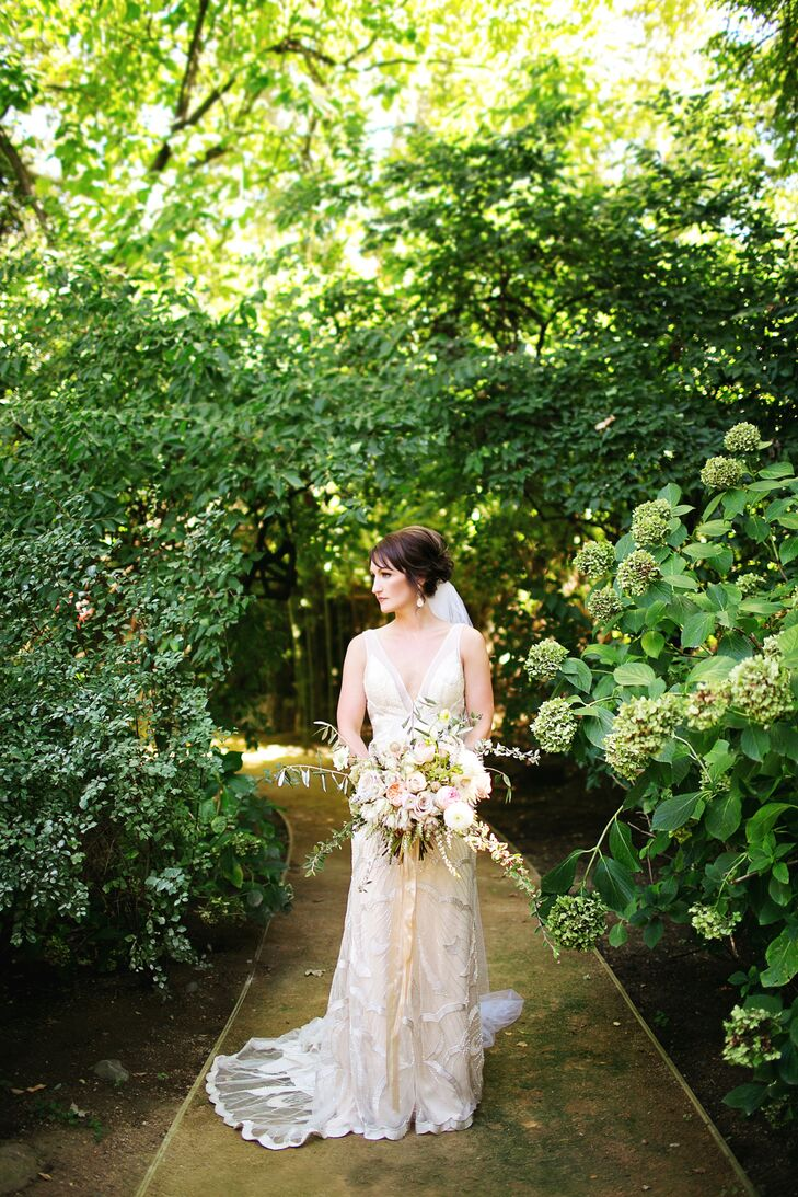"Bonny wore a cream-colored long wedding dress with a deep V-neckline that was designed by Maggie Sottero. The dress had a sheer overlay textured with sequins that gave off a glamorous touch. ""I had seen my dress in a magazine, and it was the first one I tried on,"" Bonny says. ""It's no secret that I love sparkle."""