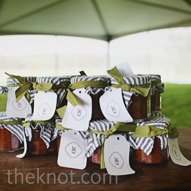 Guests took home mini jars of homemade barbeque rub topped with striped fabric.