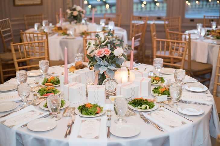 The centerpiece arrangement—pink and ivory roses and dusty miller—was in keeping with the bridal party's bouquets and boutonnieres.  Handmade golden-spool placeholders and menu cards added to the setting.