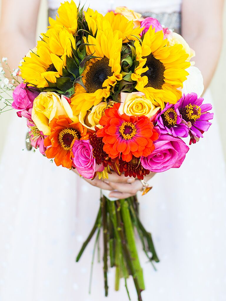 A bridal bouquet with sunflowers and zinnias